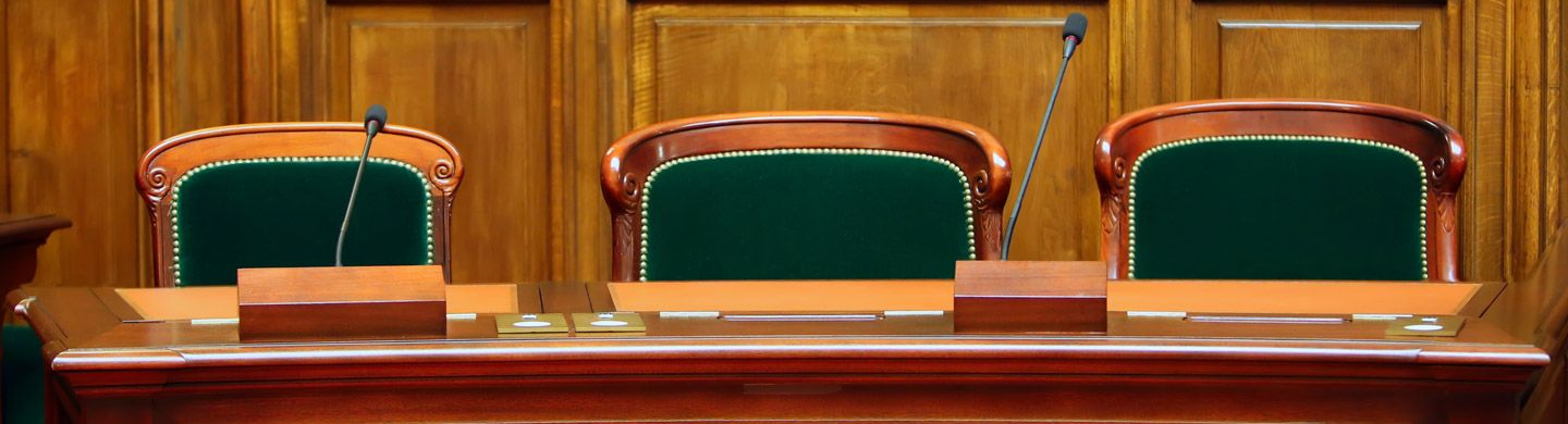 empty seats in a council chamber