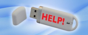 usb stick with the word help written on it
