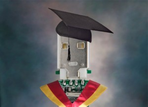 PCB wearing a gown and mortar board
